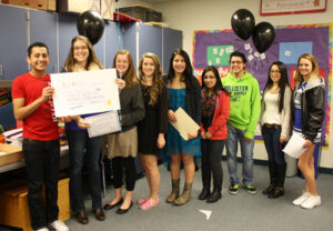 The Associated Student Body at Manson High School deliver an award to Andrea Whitney, who received $1,550 to purchase xylophones for her music class.